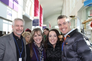"With Eric and Leslie Ludy at Districts.  Eric and Leslie Ludy are authors of the book ""When God Writes Your Love Story.""  A required read by our boys a couple years ago.  They are such sweet people.  Logan helped man their book table at the conference."