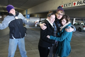 Logan saying good-bye to friends, Andrea and Katy Coon.