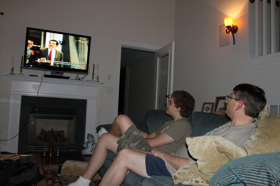 Time to relax...Zachary watching Mr. Bean with Uncle John.