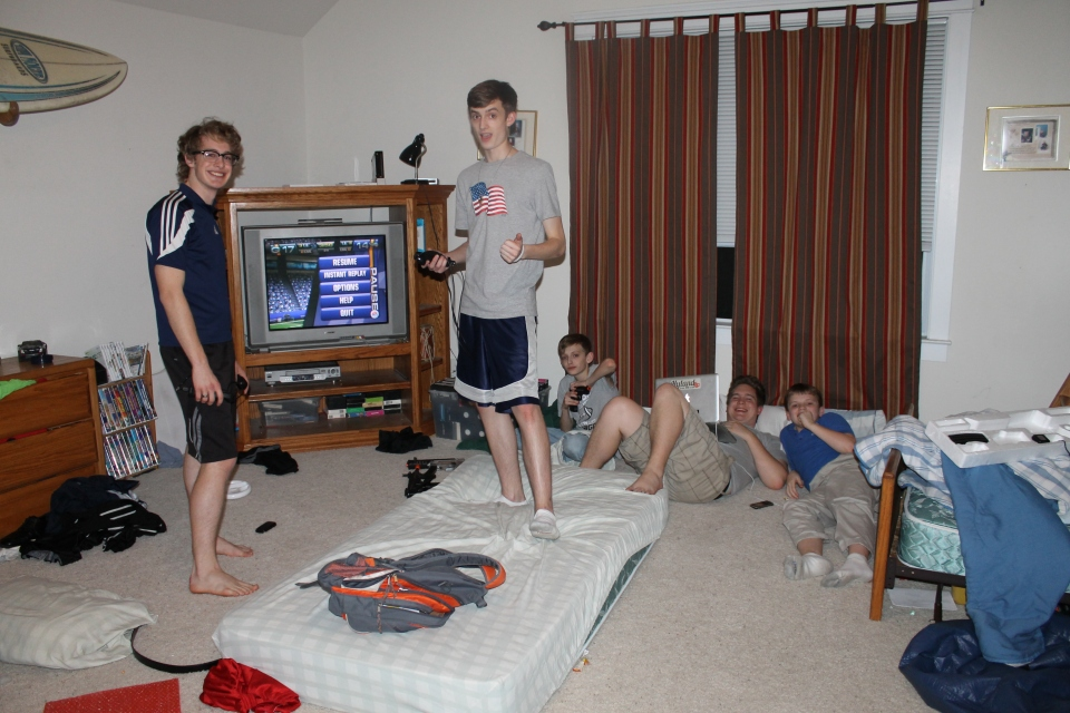 Logan playing video games with his cousins.