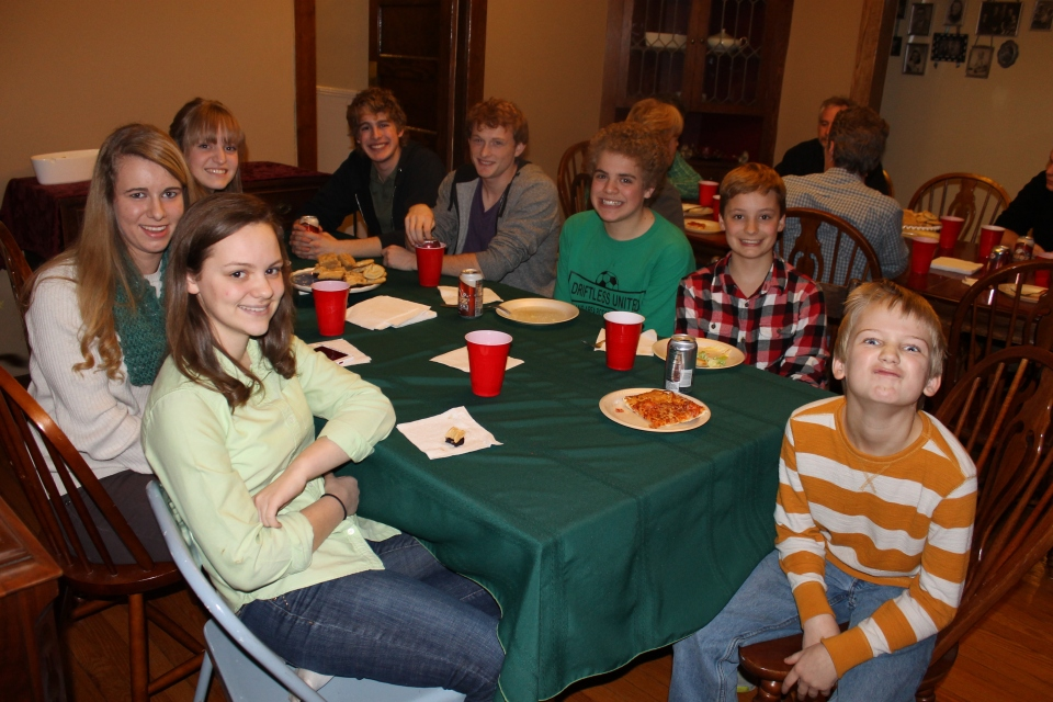 "The ""under 18"" table at Kurt and Lori Felten's house in Kentucky.  Monica, Aubrey, and Ethan Hart; Landry and Shane Jung; Zach and Logan; Ben Felten."