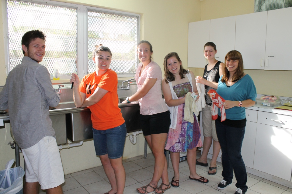 A group of Taylor University students on clean-up duty in the camp kitchen.