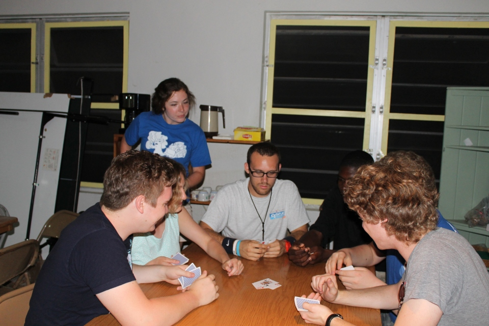 The guys playing games with the Taylor University students at the dining hall at camp.