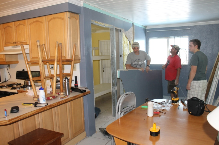 With Taylor gone, we were then able to get in to the camp house to start the renovations.  First things that had to go was the wall that divided the living room into a a bedroom and small living area.