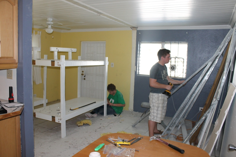 We worked all day removing the wall and tub, trying to remove large bolts from bunk beds that had been painted (it tool several hours to take apart 1 bed--there were 5 beds to disassemble), cleaning a house up to my standards, kicking out the free loaders (aka: cockroaches, termites and other critters), and attempting to get rooms ready to be painted.  I also went shopping for paint.