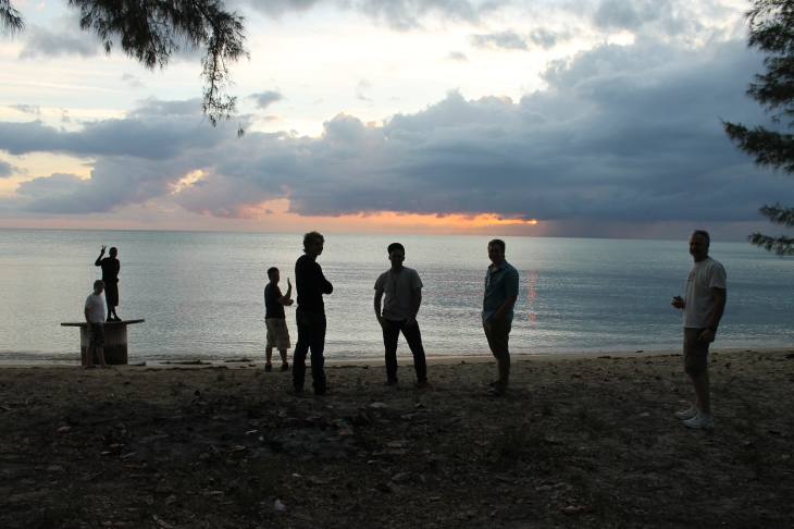 After a long day of work, we took 2 ALC facilitators and Kevin (our maintenance guy's foster son) and attempted to watch the sunset on a west side of the island beach.  We caught a glimpse of the sun just before it slipped behind the clouds on the horizon.
