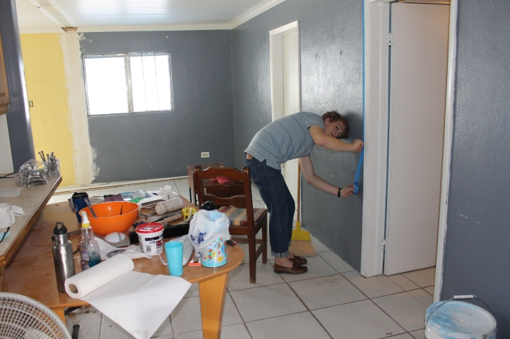 Logan helping to tape off the doors so I could paint the living room and dining room area.