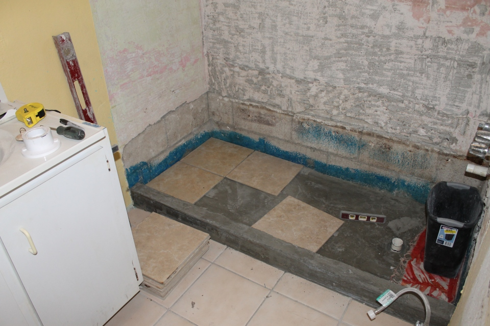 Tim began tiling the base of the shower...