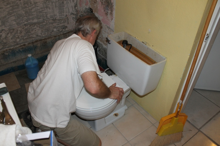 ...and setting the toilet in place so we could live in the house while we finish up the renovation.