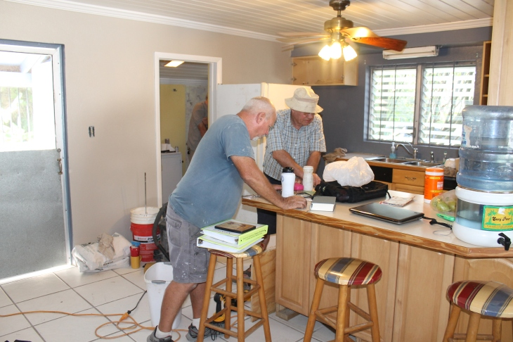 While I was running an errand, the guys got busy working on the shower.  Tim had some help from Tom and Bob.
