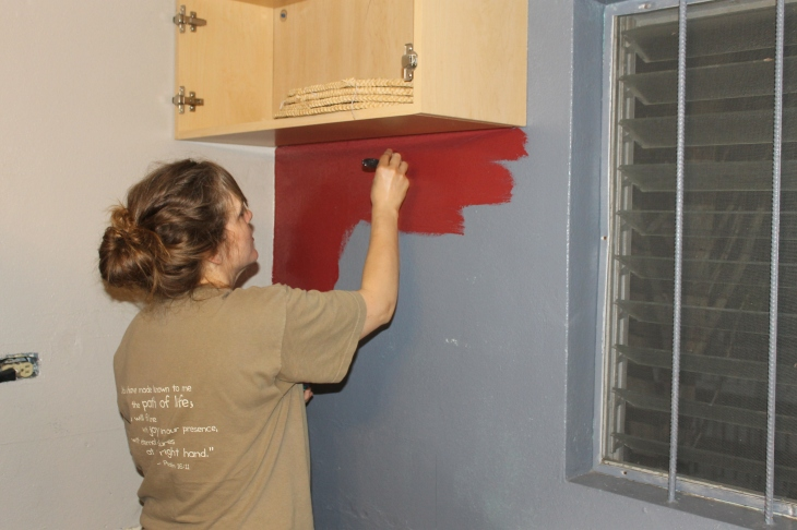 Painting the accent color on the kitchen walls.  Yes, that is red!  It looks really nice.  I can't wait to show the final product of our labors.  That will not be  on this blog post.  Sorry! You will have to check back later for that!