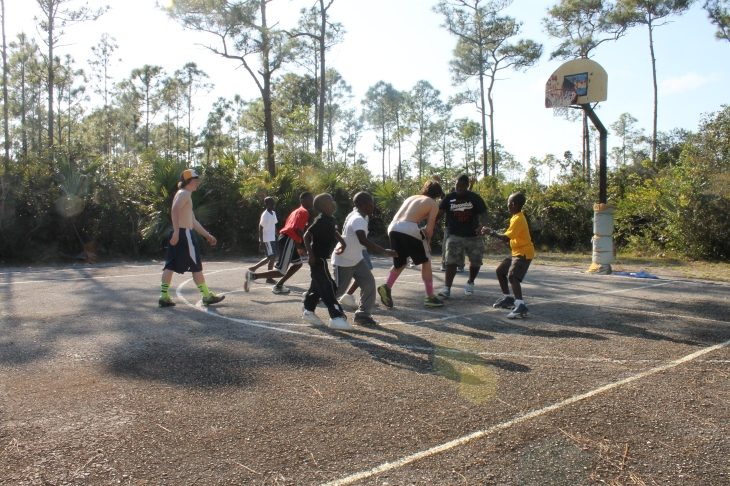 The boys on the team played basketball with the Bahamian boys.