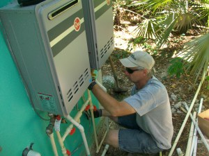 Tim installing the second water heater in the bathhouse.