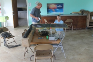 Paul and Tim repairing the Dining Hall screens.