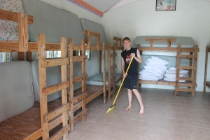 Caleb helping clean the dorms after the group left.