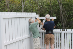 Tim and Dick moved an arm of the clothes line to the other end of the front yard.  It was originally located inside the gate and everyone seemed to hit their head on it.