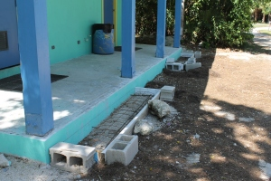 Steps to the bathhouse porch in progress