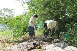 Electrician Fabian and one of the mission team members working on the electrical upgrade at camp.