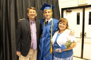 Evan's graduation picture with his proud parents.