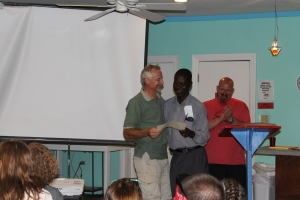Pastor Bazile from the Haitian church that some of the mission teams served that week gave out recognition forms to the mission team members.