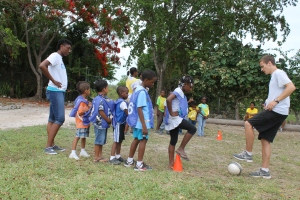 Summer day camp at the Centre is in full swing.  Nicola leading the children in games with a soccer ball.