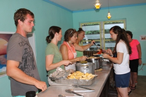Fellow ALC staff helping serve the group at meal time.