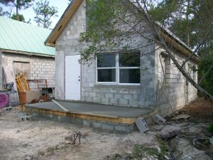 The staff cottage now has a front porch, new soffits and new places in the interior walls for conduit