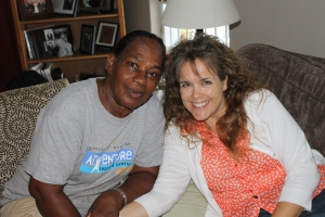 At home, after the surgery, Ms. Aida stopped in to see how Mindy's surgery went.