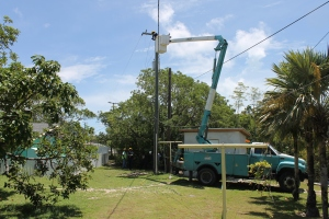 Bahamas Electric (BEC) finally came (be it  3 weeks later than promisded) to hang new power lines for our electric upgrade at camp.  They shut down the power for 3 hours, not just to our site but to the whole section of this side of the island.  We were joking that we hoped our neighbors would not hold it against us.  BEC left that day with a promise to come back in a few days to hang the transformers.