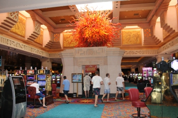 "This is the casino area of Atlantis.  You have to walk through it, but besides affording us with a view of how many people waste their hard earned money, we get to enjoy the beautiful art work.  This is a ""sun"" sculpture.  It is gorgeous."