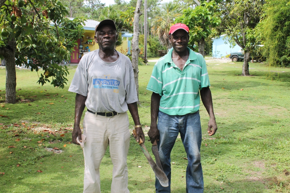 Celavie and Napela.  These two gentlemen are responsible for keeping the grounds of the ALCentre and the ALCamp so beautiful.  They do not use edge trimmers to keep edging trimmed and weeds pulled, they use that machete.  They are hard workers.