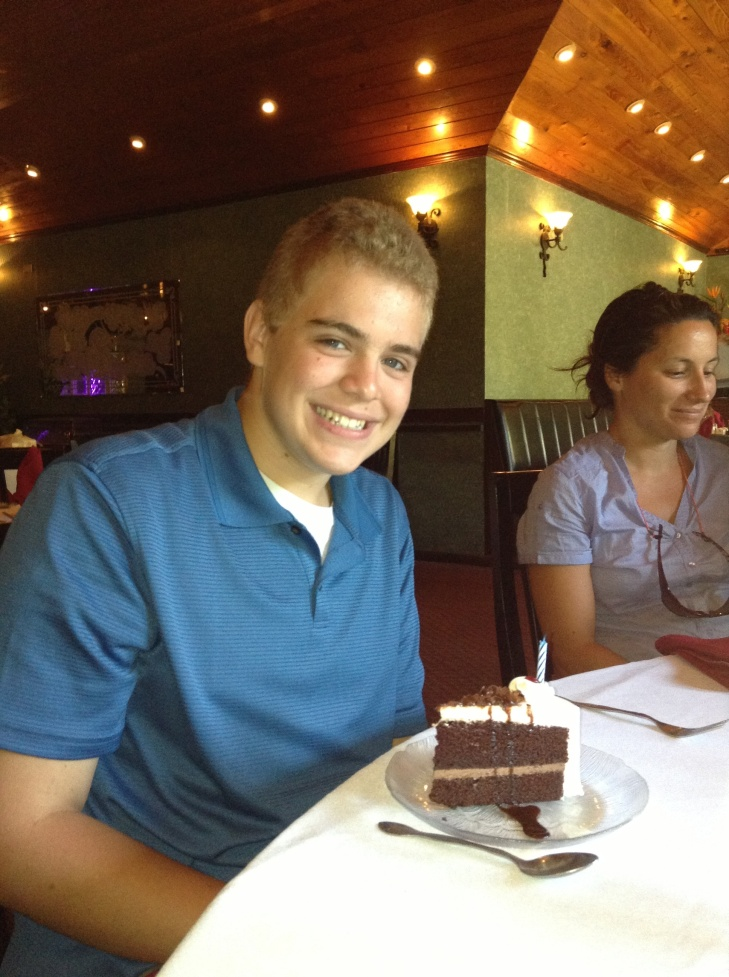 We went out to a Chinese restaurant for lunch, and thanks to Roger and Grace Grebe who insisted we have dessert, Zachary had a birthday cake with a candle even.