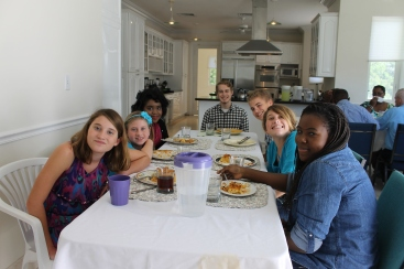 After Jay spoke in the am service at Kingdom life, we met at our pastor's house.  This was the young people's table.  From left to right is Keaton and Kendall Bunting, Deborah (pastor Cedric's niece), Logan, Zachary, Kara Bunting, and Abby Moss.