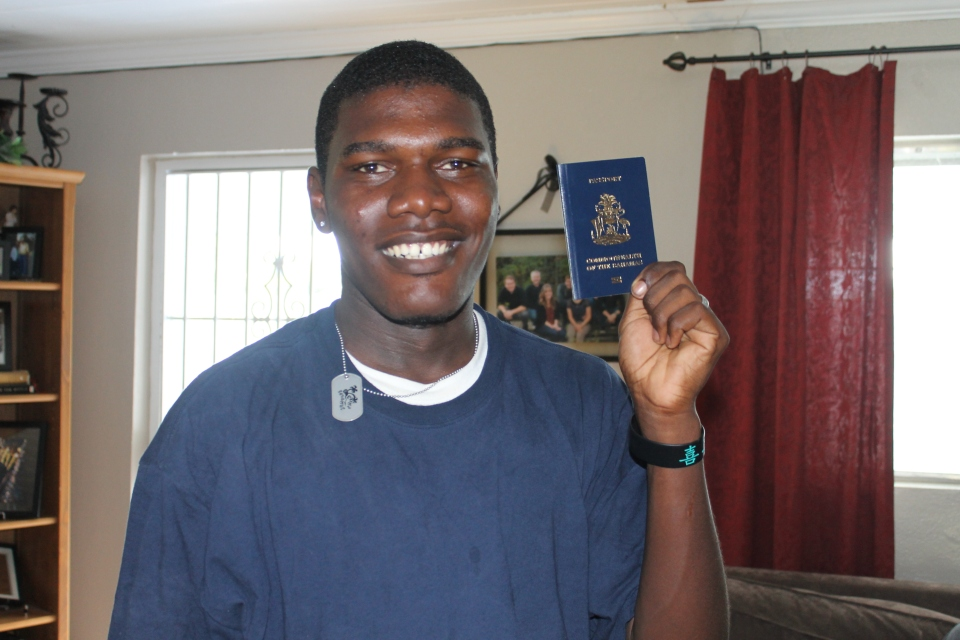 Kevin stopped by to show off his passport.  He finally got it.  Tom had been working on getting this with him since we arrived in January.  He is so proud of finally having a passport.  Now he can leave the Bahamas.