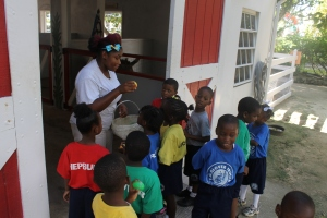 Tika Penn, facilitating  a program in the petting farm area of Adventure Learning Centre.  Kudos to Facilitator staff who have been extremely busy ministering to 100's of Bahamian children.