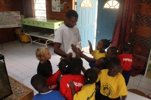 Elton Deetjen, another of our program facilitators at the Centre, demonstrating the small animals in the nature centre.