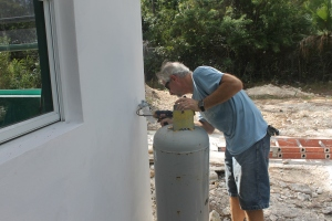 Tim is finishing up the installation of the gas line that will fuel the water heater and the stove.