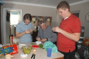 The guys were shelling pigeon peas.  It was my first attempt at making peas n' rice (a Bahamian dish)...