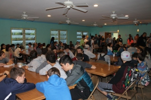 Sleeping arrangements weren't the only challenge we faced by having this huge group.  Our dining hall is not designed for a group of 100 people.  Meal time was a challenge.  Please pray as we work on plans to increase our cooking and dining capacity at camp.
