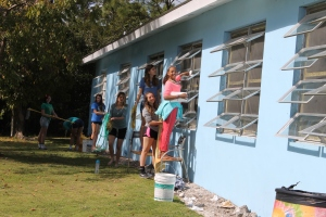 To fill some time, the young people helped so some light work projects around camp.  One thing they did was wash windows...