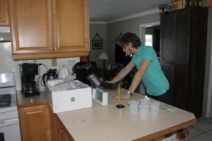Logan working on a science experiment for his LUO biology class.