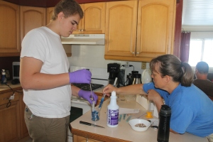 Judi working with Zachary on his school chemistry experiment.  Judi studied food science.