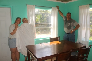 One of the finishing touches to the inside of the girl staff cottage is the making and hanging of the curtains.  Faye Browning used donated white sheets from Atlantis to make the curtains, and Bob and Judi helped construct and hang the hardware.