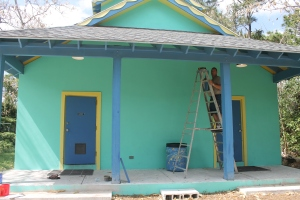 Bob worked on adding light fixtures to the bath house porch.  We now have a lighted porch.