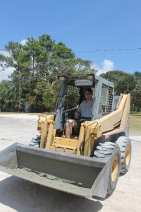 Pastor Keith Wilson got the fun job of operating the Bobcat.