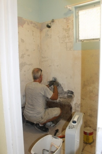 ...demolishing the moldy, leaky shower in the camp kitchen apartment to make way for a new tiled, shower...