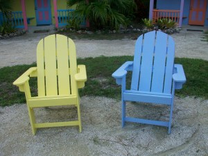 Tim has been building Adirondack chairs.  We have six cabin colored chairs and 4 white chairs.  Tim has had some help in making these.