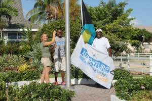 Representative of the past, present and future staff of the ALC:  Julian (past), Elton (present), and Megan (future) raised the flag as the Centre hosted a group of children brought to us by Scotia Bank.