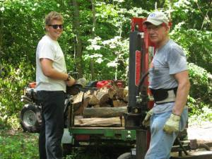Meanwhile, back in the USA...On June 10th we allowed Zachary to go to the states for a 5 week trip.  He started at my parent's house in Indiana where he helped grandpa cut and stack wood...