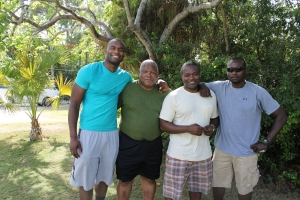 Myron Rolle (left) with his father and two of his four brothers.
